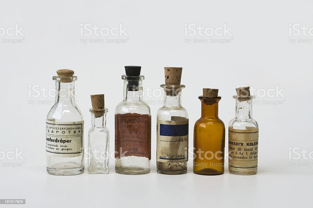 Group of small vintage translucent medicine bottles. stock photo