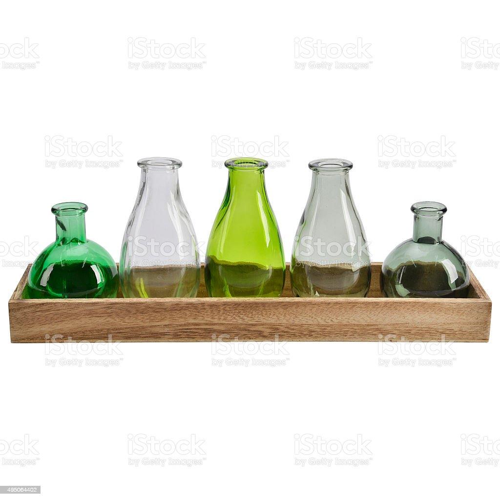 Group of small vintage translucent medicine bottles stock photo