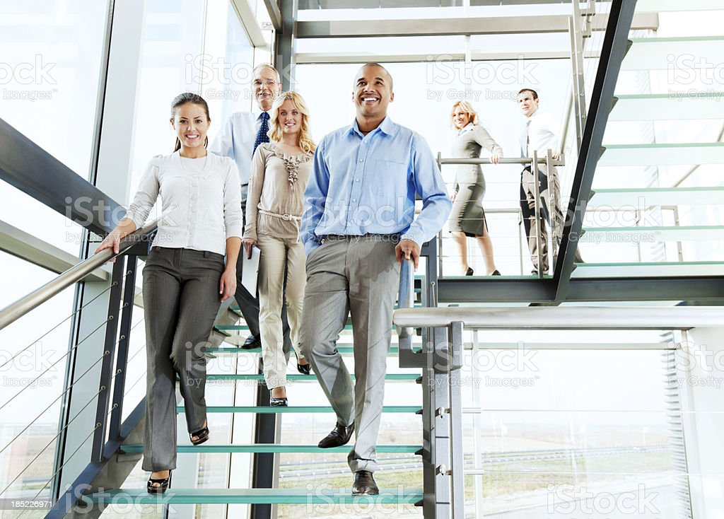 Group of smiling businesspeople on the staircase. royalty-free stock photo