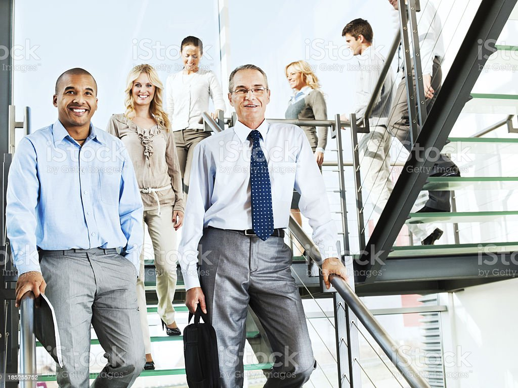 Group of smiling businesspeople people on the staircase. royalty-free stock photo