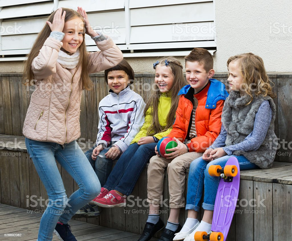 Group of smiling children playing charades stock photo