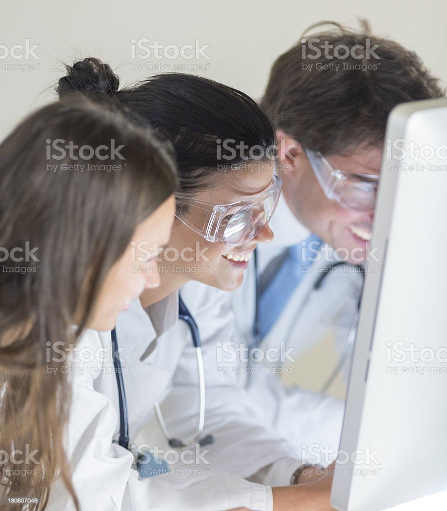 Group of smiling doctors in the laboratory royalty-free stock photo