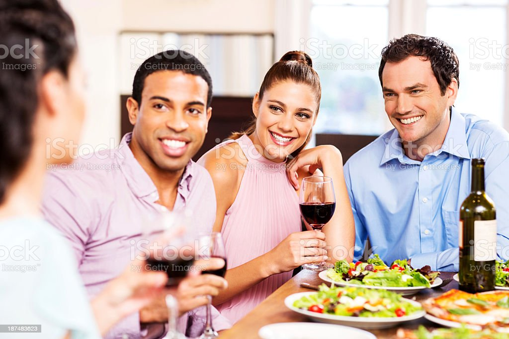 Group Of Smiling Friends Making A Toast In Restaurant royalty-free stock photo