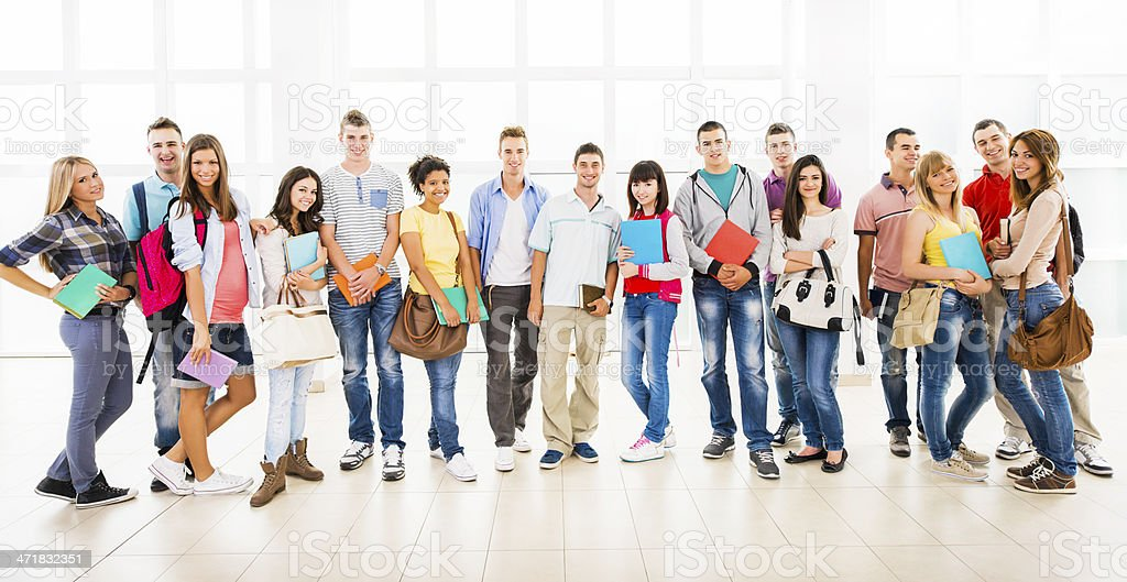 Group of smiling students looking at the camera. stock photo