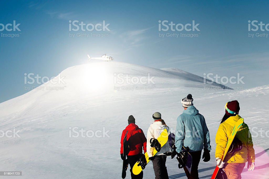 Group of snowboarders enjoying a beautiful Winter morning Concep stock photo
