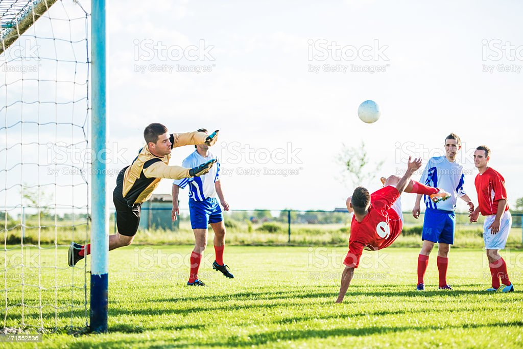 Group of soccer players playing soccer. stock photo