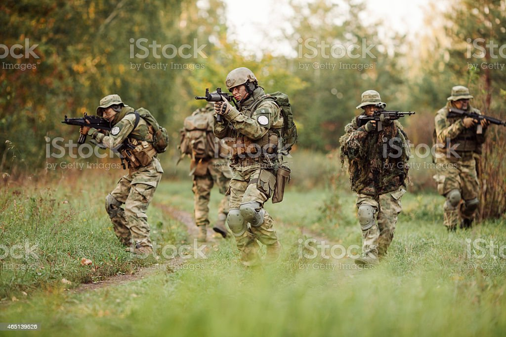 group of soldiers engaged in the exploration area stock photo