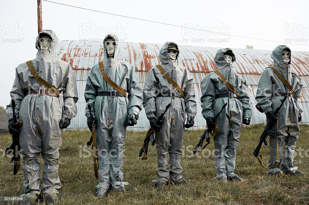 Group of soldiers with guns in their masks stock photo