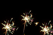 Group of sparklers isolated. Christmas Eve decoration.