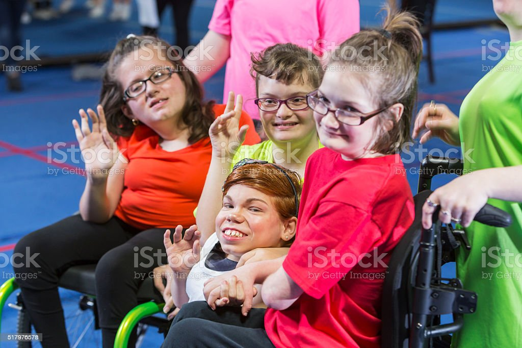 Group of special needs girls in gym exercise class stock photo