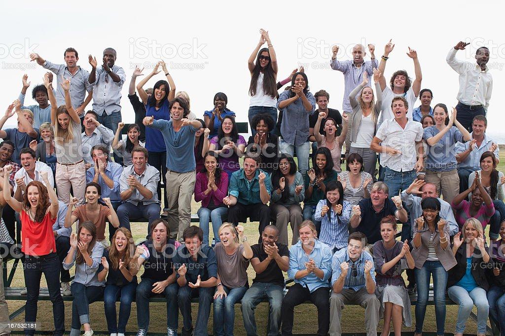 Group of spectators cheering stock photo