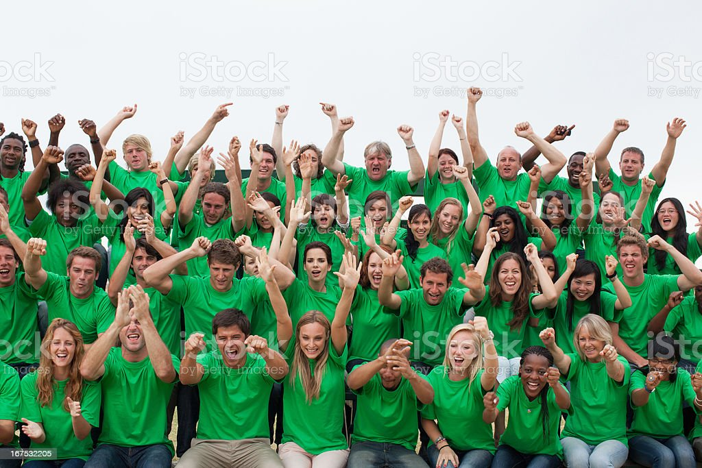 Group of spectators cheering royalty-free stock photo