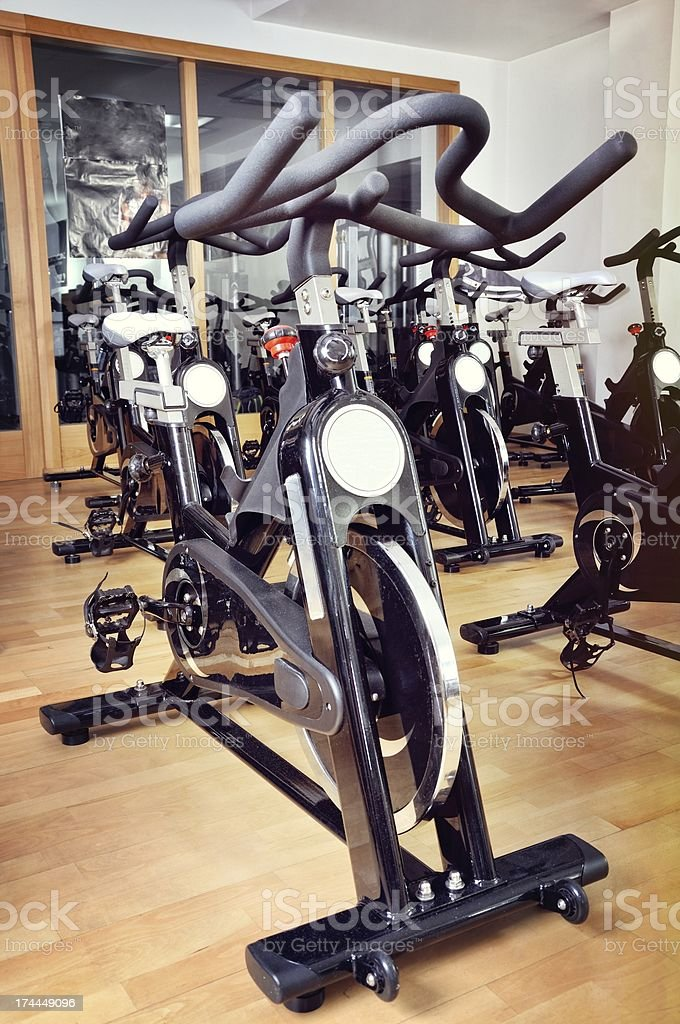 Group of spinning bicycles at fitness studio royalty-free stock photo