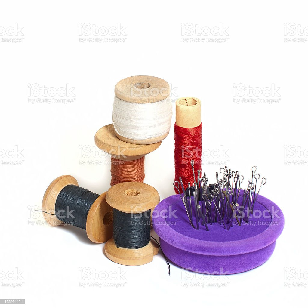 Group of spools with thread and needle bed stock photo