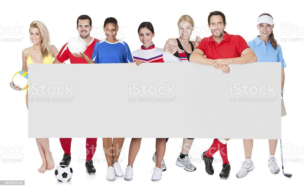 Group of sports people presenting empty banner royalty-free stock photo