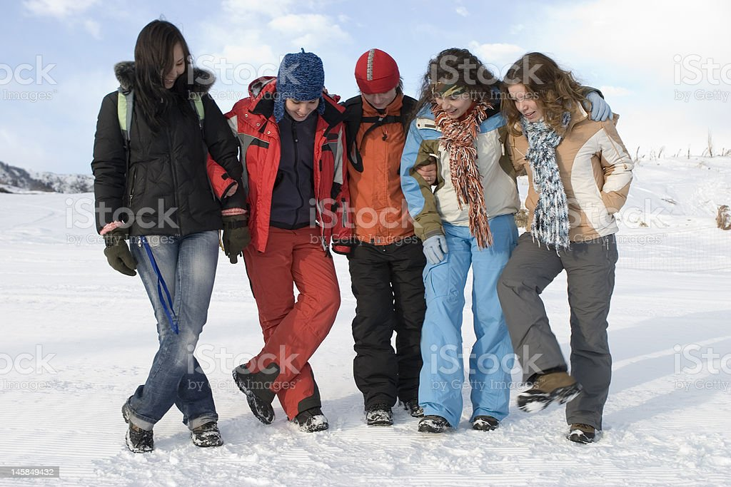 Group of sports teenagers in mountains, over blue sky royalty-free stock photo