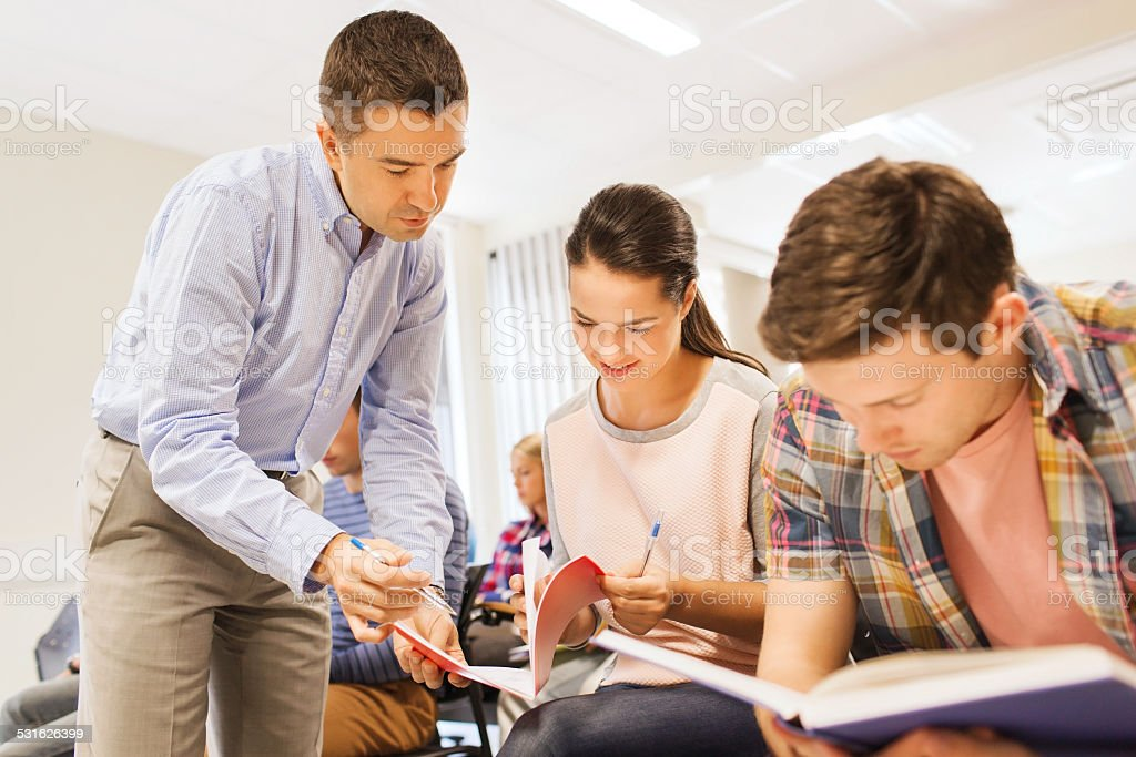group of students and teacher with notebook stock photo