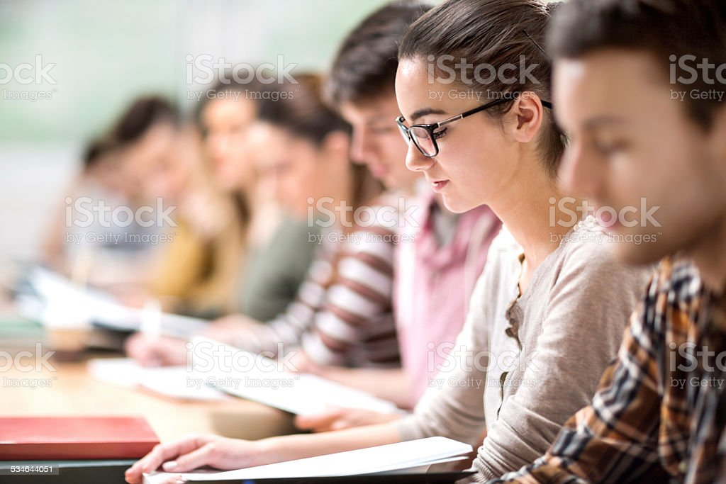 Group of students at classroom. stock photo