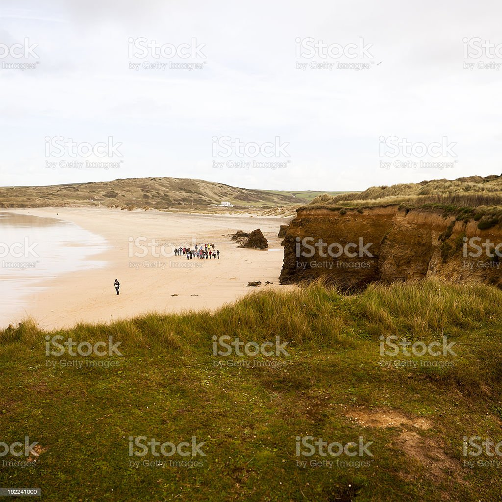 Group of students at Gwithian Bay royalty-free stock photo