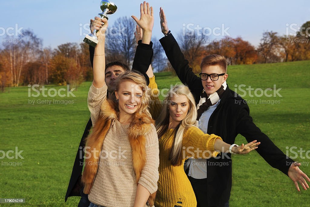 Group of students celebrating royalty-free stock photo