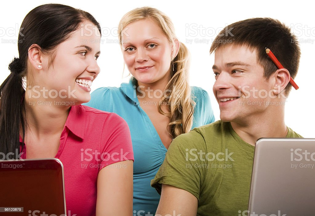 Group of students having fun, doing home work royalty-free stock photo