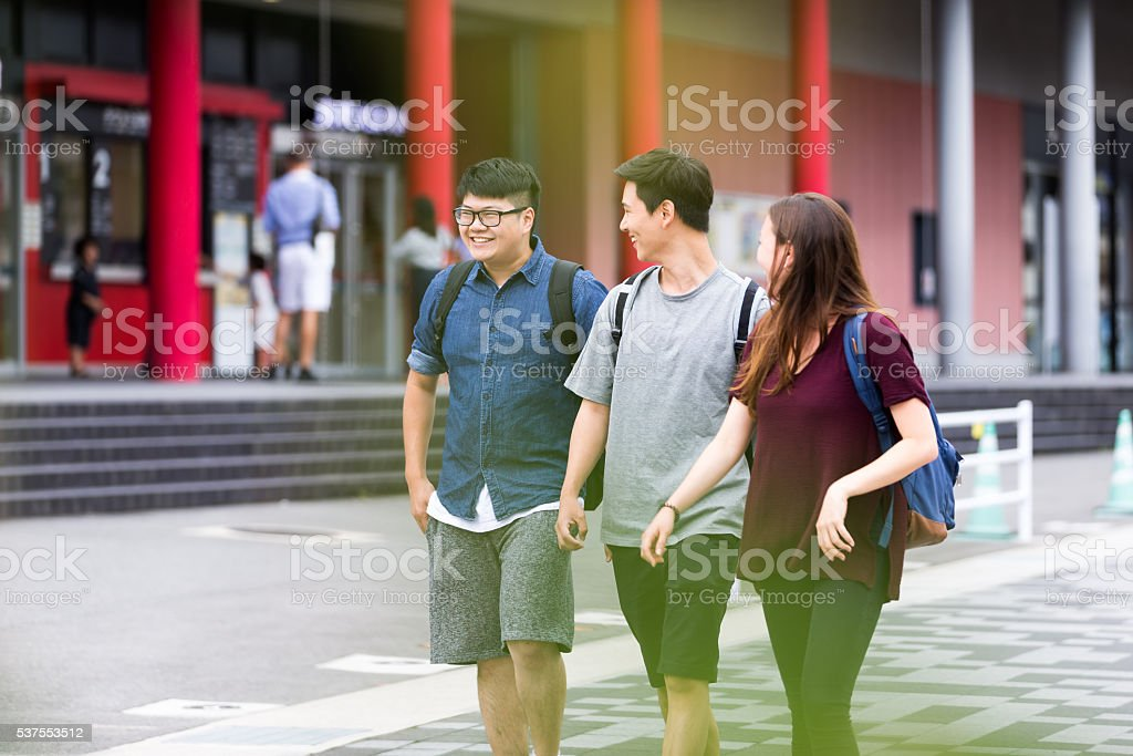 Group of Students having fun outside their campus stock photo