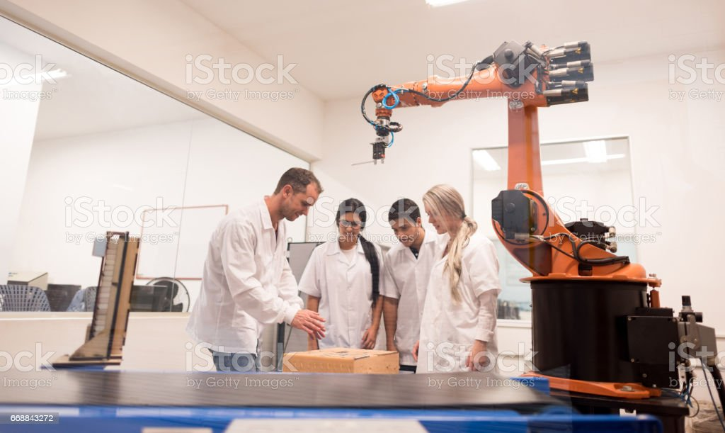 Group of students in a mechatronics class stock photo