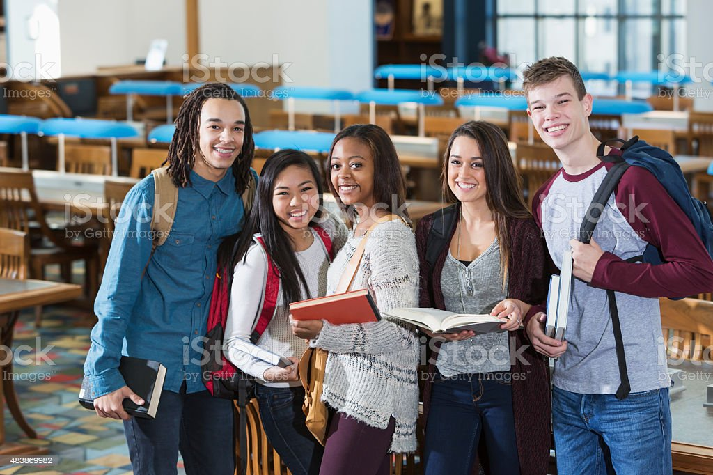 Group of students in library reading room stock photo