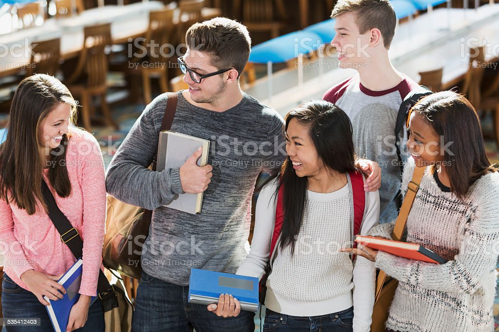 Group of students in the library stock photo