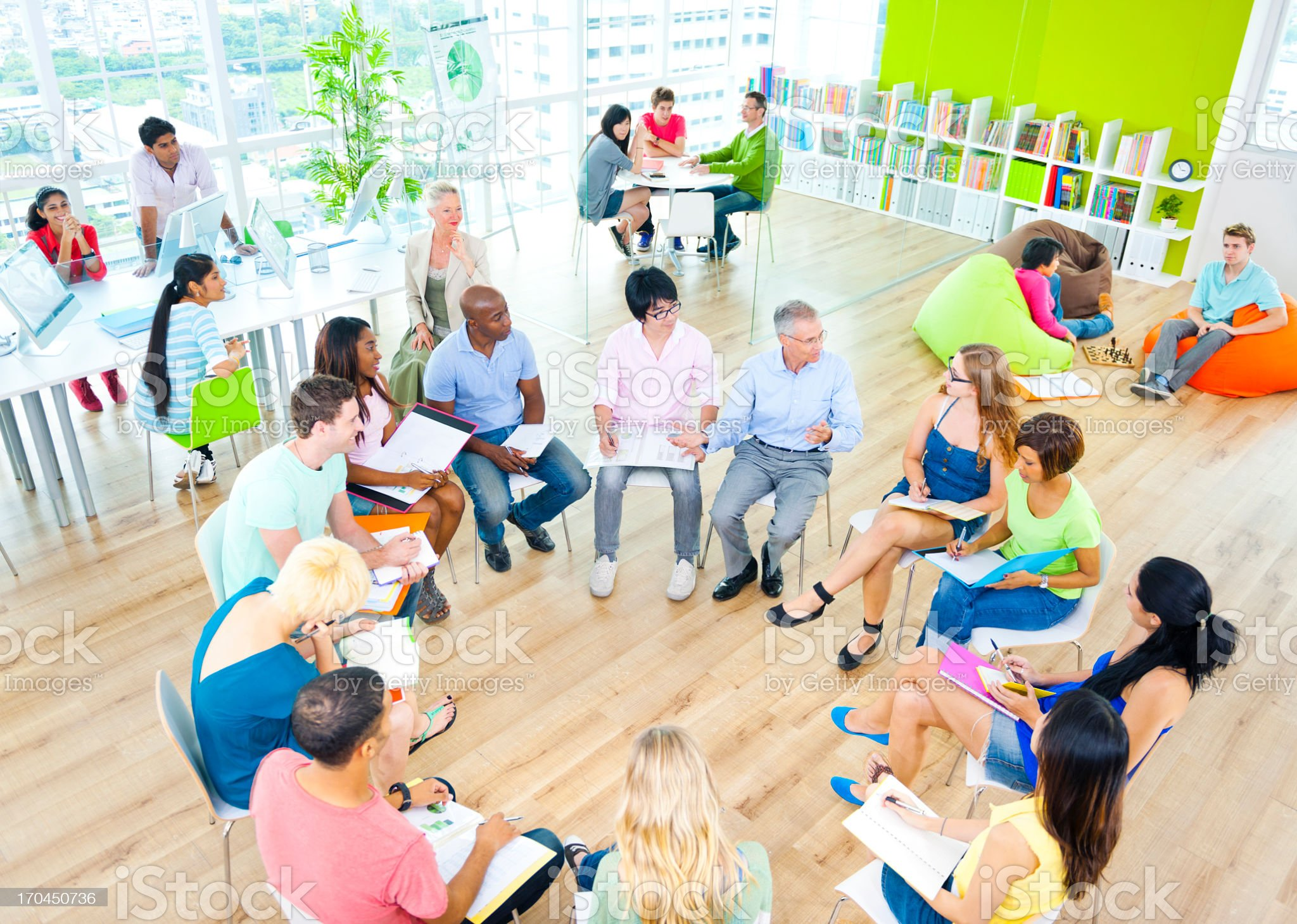 Group of students meeting in an informal circle royalty-free stock photo