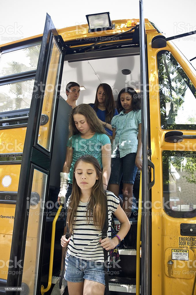 Group of students off the bus royalty-free stock photo