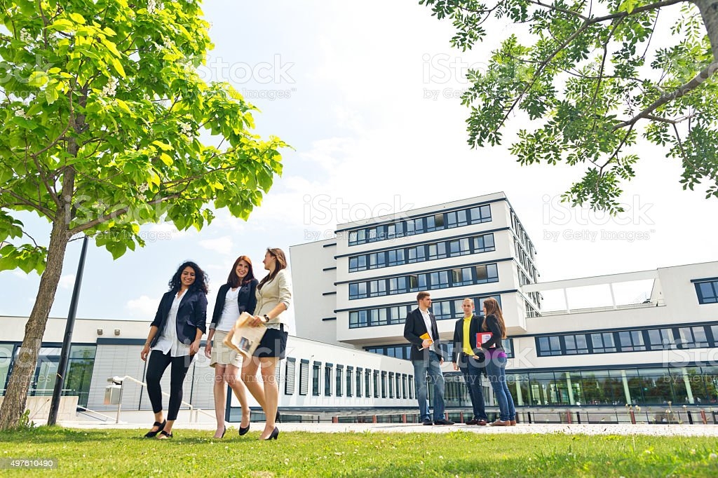 group of students on campus stock photo