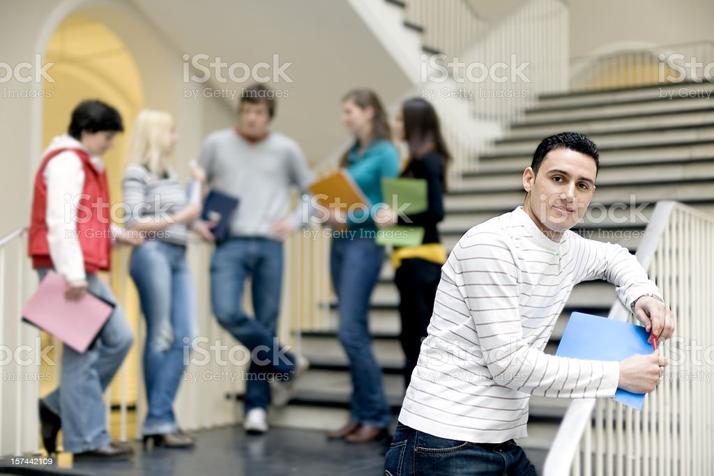 Group of students on staircase in discussion stock photo