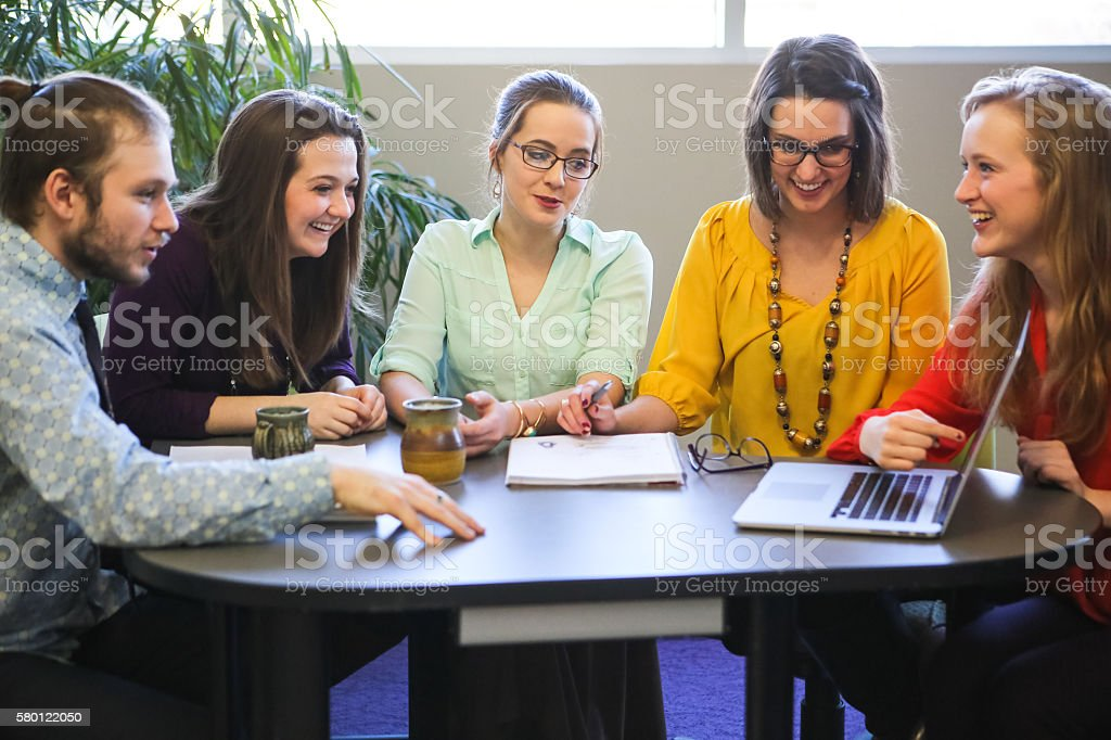 Group of Students or Young Business People Discussing Projects Plans stock photo