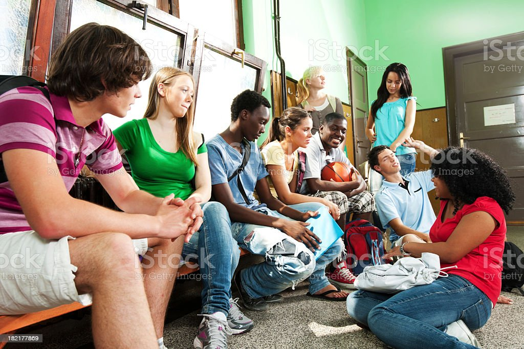 Group of students relaxing during the school break. stock photo