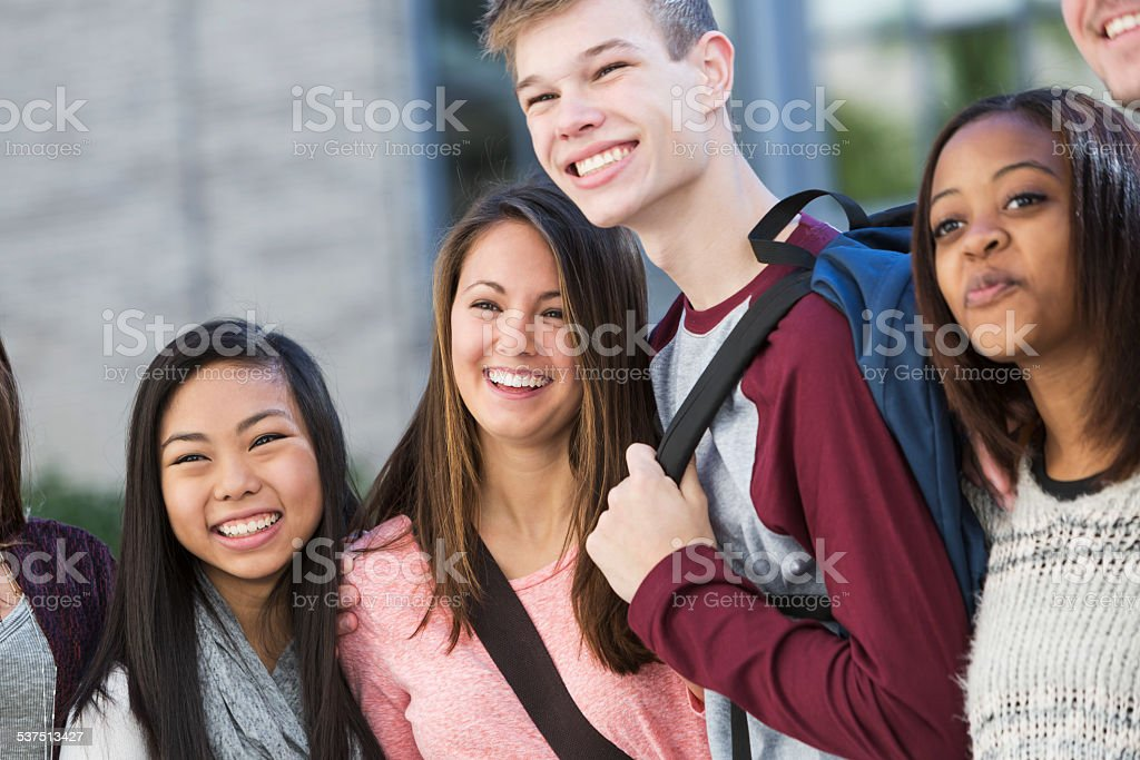 Group of students standing in a row outdoors stock photo