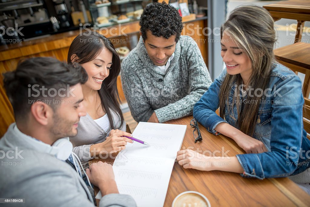 Group of students studying at a cafe stock photo
