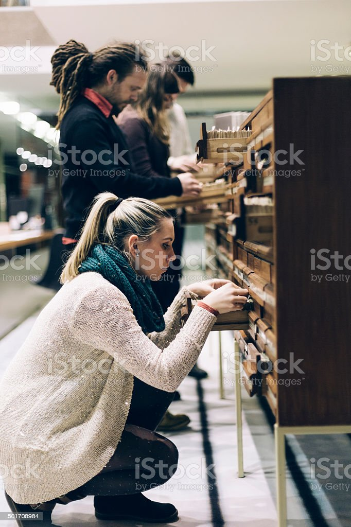 Group of Students Studying in a Library stock photo