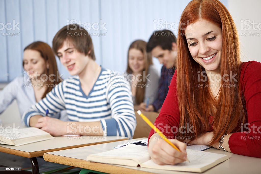 Group of students studying in classroom royalty-free stock photo