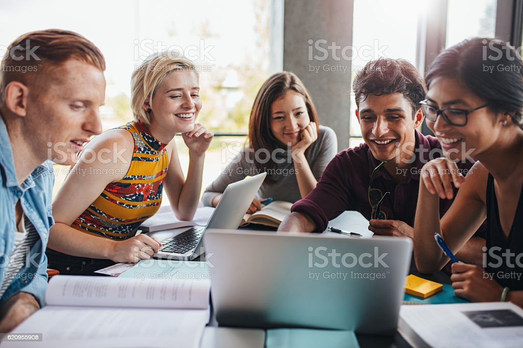 Group of students studying in the library stock photo