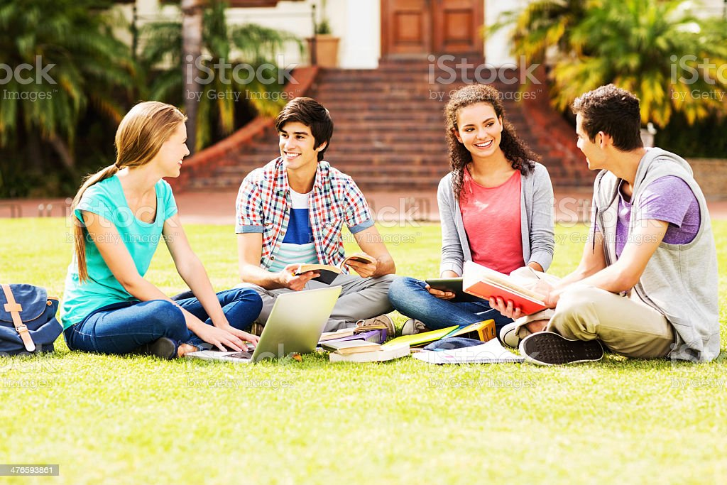 Group Of Students Studying Together In Quad On College Campus royalty-free stock photo