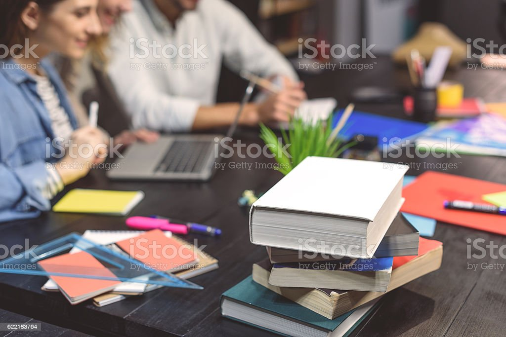 Group of students studying together stock photo