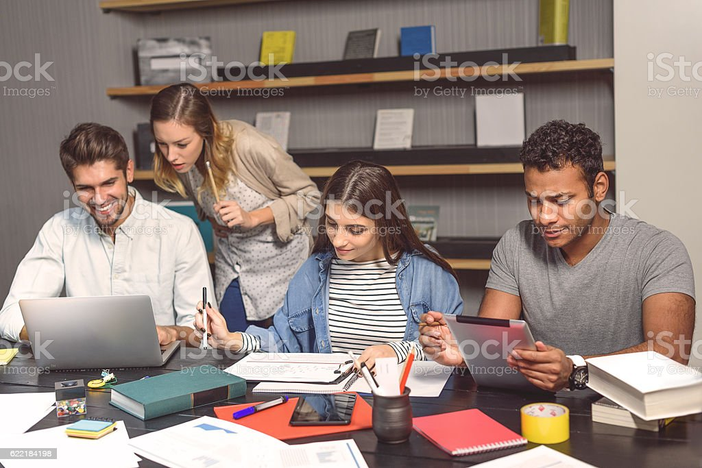 Group of students studying with joy stock photo
