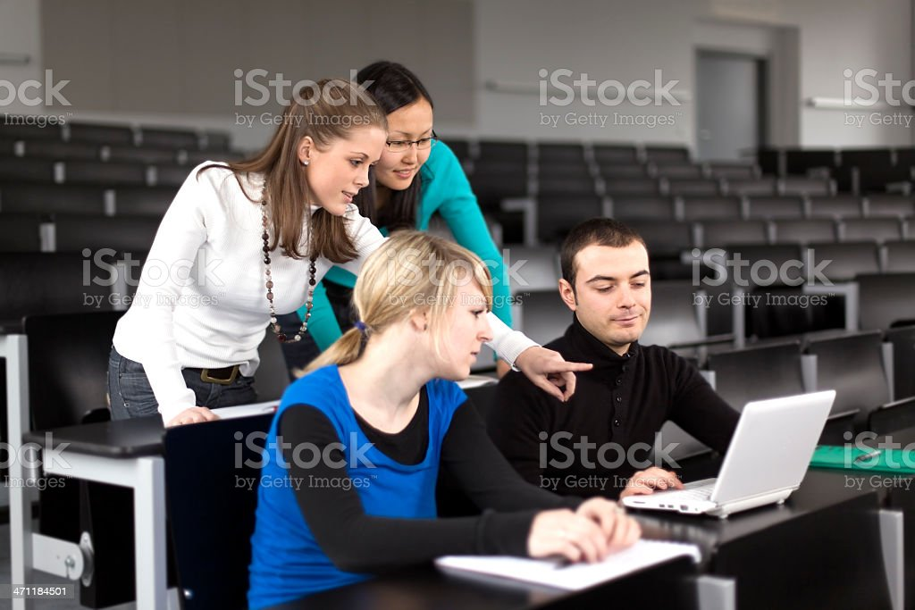 Group of students teamwork with laptop in lecture hall (XL) royalty-free stock photo