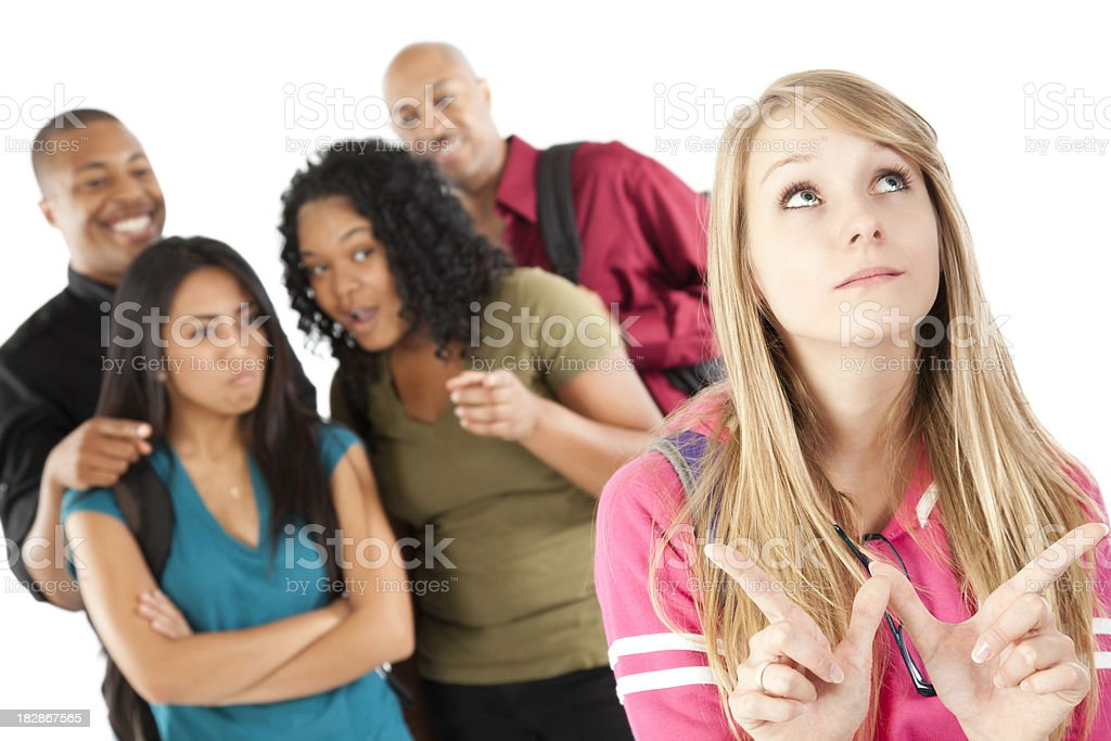 Group of Students Teasing Girl Who Doesn't Care stock photo