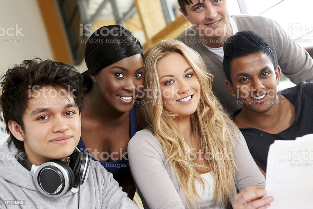 Group of students together at college library royalty-free stock photo