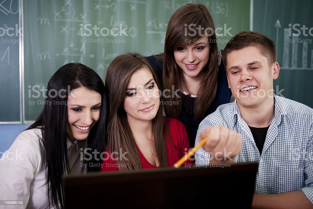 Group of students using computer royalty-free stock photo