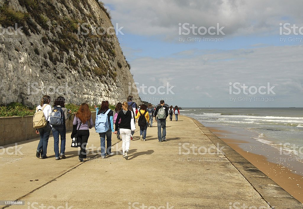 Group of Students Walking the Foreshore, Kent royalty-free stock photo