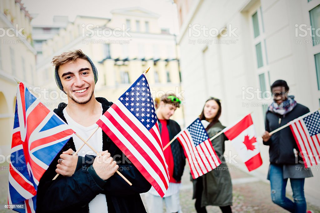 Group of students with flags of English language countries stock photo