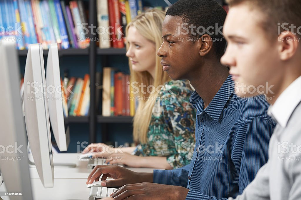 Group Of Students Working At Computers In Classroom royalty-free stock photo